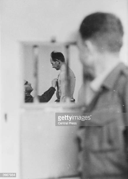 Austrian Nazi war criminal Karl Adolf Eichmann undergoing a medical examination in prison