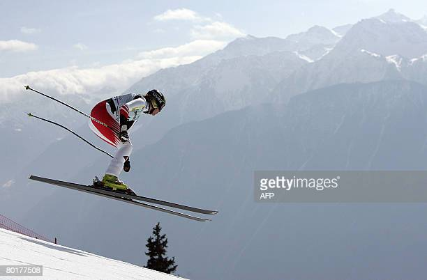 Austrian Nicole Hospe jumps during the downhill on her way to take eighth place of the supercombined race at the FIS alpine skiing World Cup on March...