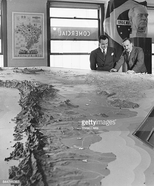 Austrian novelist Stefan Zweig looking at a model of Brazil at the Brazilian Information Center New York circa 1930