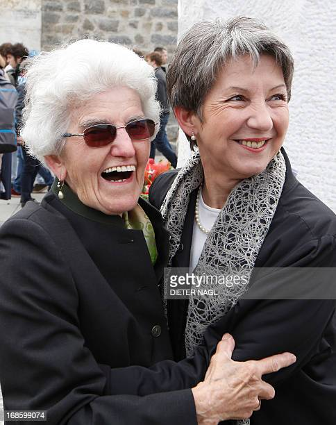 Austrian Parliament President Barbara Prammer hugs Anna Hackl during a commemoration of the liberation of the Nazi concentration camp Mauthausen on...