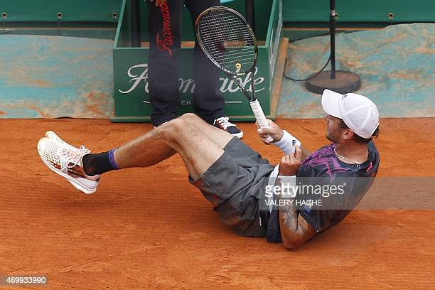 Austrian player Andreas Haider Maurer falls during his tennis match against Serbian player Novak Djokovic during the MonteCarlo ATP Masters Series...