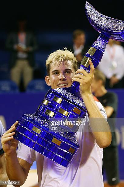 Austrian player Dominic Thiem holds the trophy after defeating Portuguese player Joao Sousa during the ATP Croatia Open tennis tournament final match...