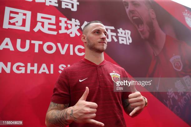 Austrian player Marko Arnautovic poses at an event held to introduce him as a new player for Chinese Super League football team Shanghai SIPG, in...