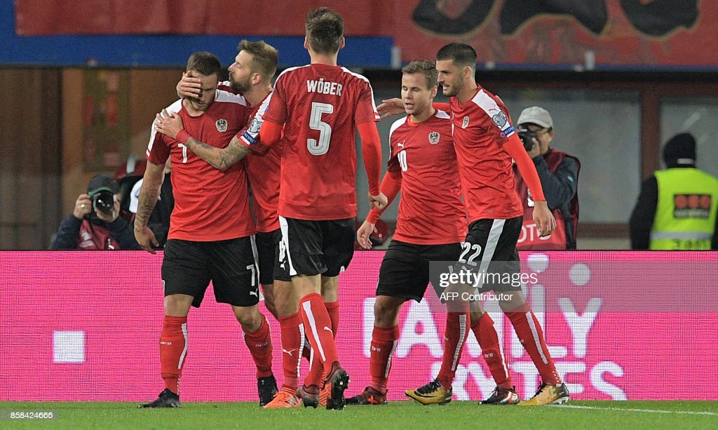 Austrian players celebrate after scoring a second goal during the FIFA World Cup 2018 qualification football match between Austria and Serbia at the Ernst Happel stadium in Vienna on October 6, 2017. /