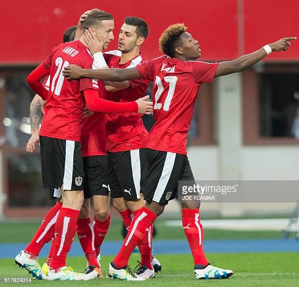 Austrian players celebrate scoring the 10 goal during the friendly football match between Austria and Albania in the ErnstHappel stadium in Vienna on...