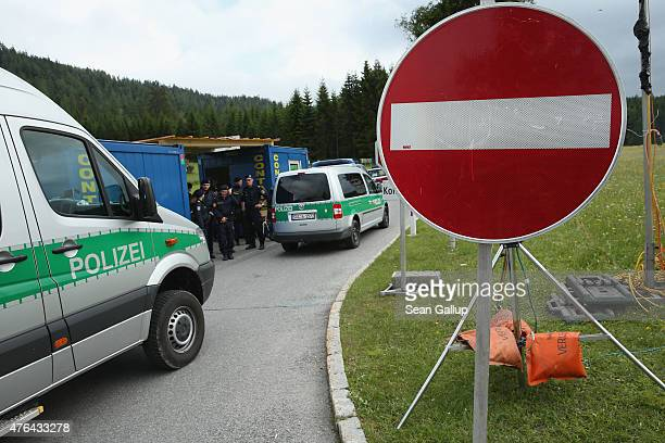 Austrian police maintain a checkpoint on a road leading to the Interalpen-Hotel Tirol, venue of the upcoming Bilderberg conference, on June 9, 2015...