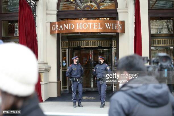 Austrian police officers stand guard at the entrance of the Grand Hotel Wien during the meeting of Joint Comprehensive Plan of Action for the...