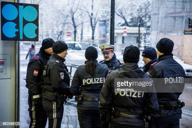 Austrian police officers stand guard outside the OPEC Secretariat ahead of the 173rd Organization of Petroleum Exporting Countries meeting in Vienna...