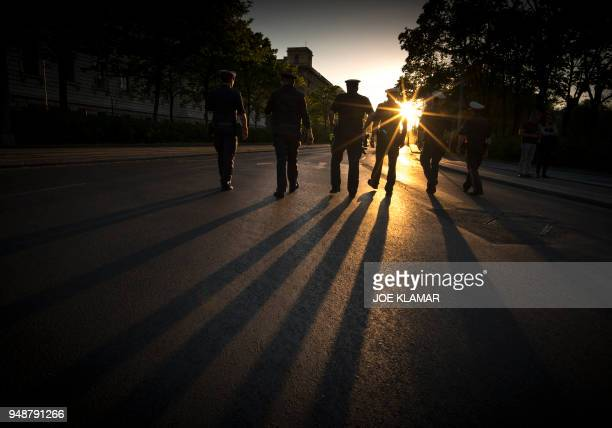 Austrian police patrol as activists and supporters of the Austria's left oriented Linkswende attend a protest march to demand a resignation of...