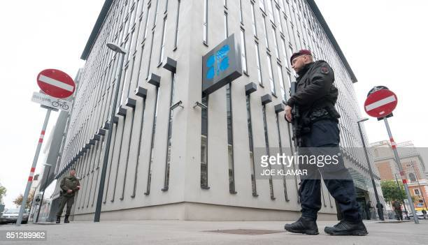 Austrian policemen guard entrance to the Organization of the Petroleum Exporting Countries headquarters in Vienna on September 22 2017 / AFP PHOTO /...