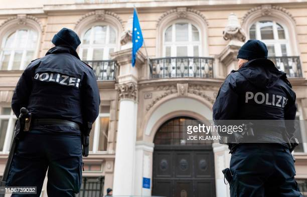 Austrian policemen stand on guard outside of the EU Delegation to the International Organizations office during the Meeting of the JCPOA Joint...