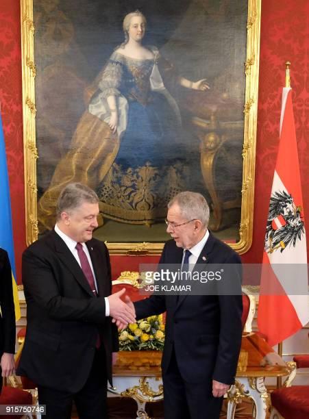 Austrian President Alexander Van der Bellen shakes hands with Ukrainian President Petro Poroschenko during a meeting in Vienna Austria on February 8...