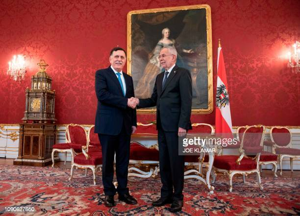 Austrian President Alexander Van Der Bellen shakes hands with the Chairman of the Presidential Council of Libya and prime minister of the Government...