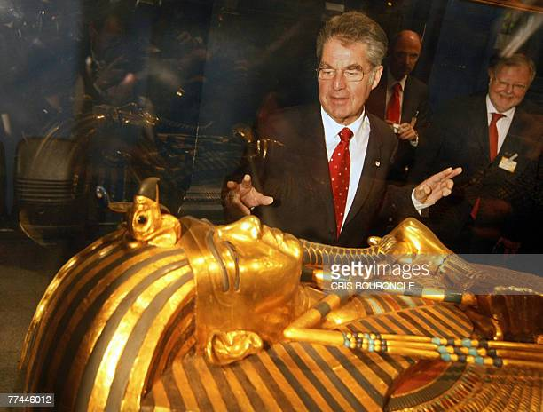 Austrian President Heinz Fischer observes one of King Tutankhamun's gold sarcophagus exhibited in the Egyptian Museum in Cairo 22 October 2007...