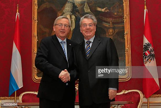 Austrian President Heinz Fischer shakes hands with Luxembourg's Prime Minister Jean Claude Juncker as part of his visit to Vienna on March 18 2013...