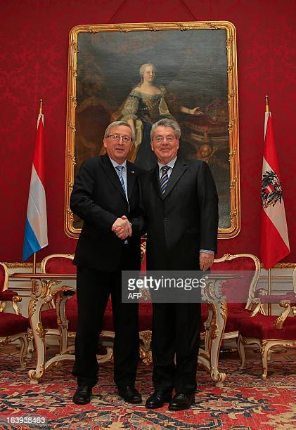 Austrian President Heinz Fischer shakes hands with Luxembourg's Prime Minister Jean Claude Juncker during his visit to Vienna on March 18 2013...