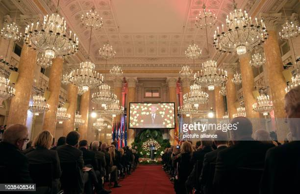 Austrian President Heinz Fischer speaks to the guests during a state ceremony on the occasion of the 70th anniversary of the restoration of the...
