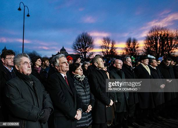 Austrian President Heinz Fischer together with Austrian Chancellor Werner Faymann take party in a rally themed 'Together against terror' on January...