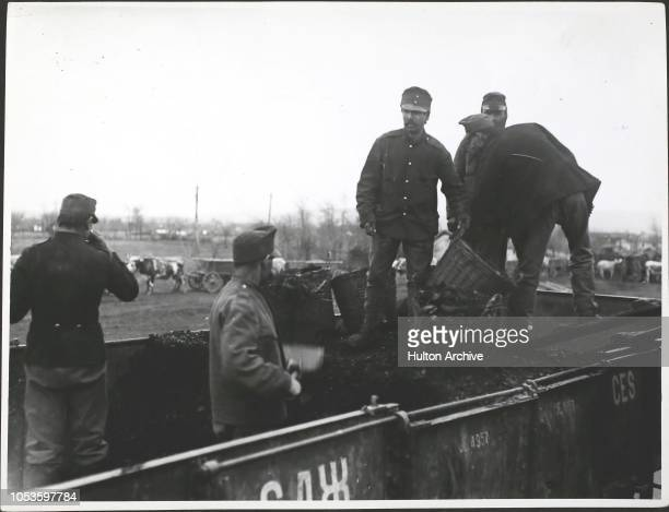 Austrian prisoners loading engine with coal Balkan