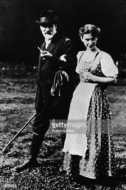 Austrian psychoanalyst Dr. Sigmund Freud walks outdoors with his daughter Anna while on a trip in the Dolomite mountain range, 1912.