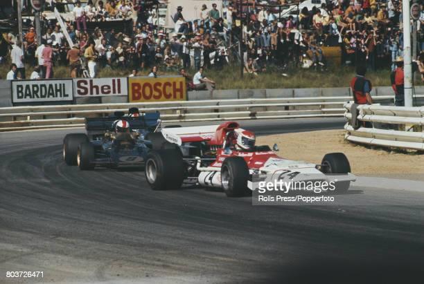 Austrian racing driver Helmut Marko drives the AustriaMarlboro BRM BRM P153 BRM V12 ahead of Dave Walker in the John Player Team Lotus Lotus 72D...