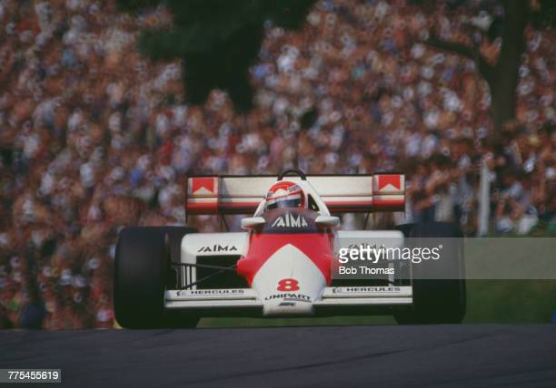 Austrian racing driver Niki Lauda drives the Marlboro McLaren International McLaren MP4/2 TAG TTE PO1 15 V6t to finish in first place to win the 1984...