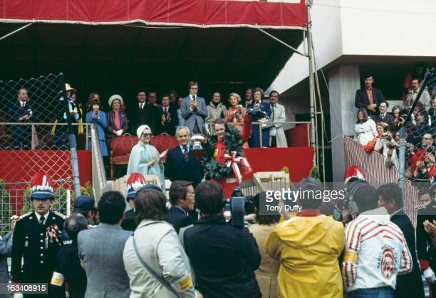 Austrian racing driver Niki Lauda wins the Monaco Grand Prix in his Ferrari 11th May 1975 Prince Rainier III of Monaco and Princess Grace are there...