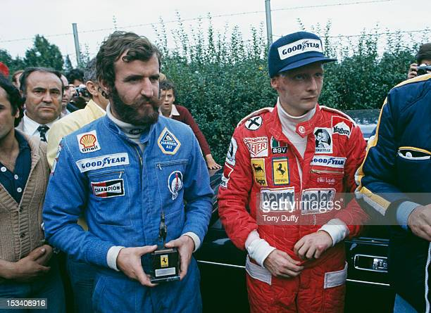 Austrian racing driver Niki Lauda with driver Harald Ertl during the Italian Grand Prix at Monza 12th September 1976 Ertl helped pull Lauda from the...