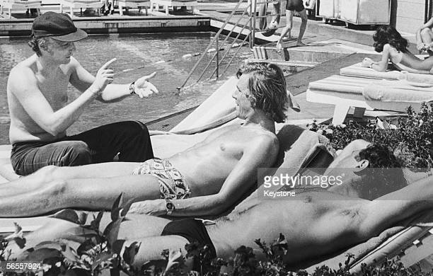 Austrian racing driver Niki Lauda with his English rival James Hunt chatting by the swimming pool of the Sheraton Hotel in Buenos Aires January 1977...