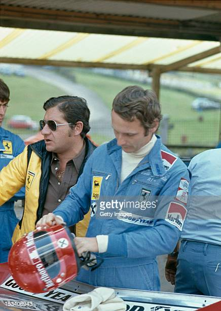 Austrian racing driver Niki Lauda with the Ferrari team manager at the British Grand Prix Brands Hatch 20th July 1974