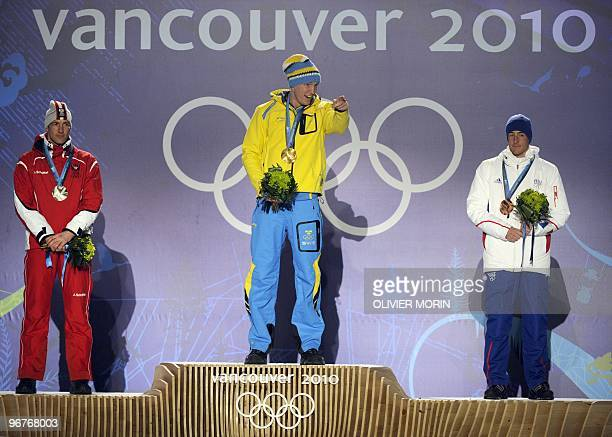 Austrian silver medallist Christoph Sumann Swedish gold medallist Bjorn Ferry and French Bronze medallist Vincent Jay stand on the podium during the...