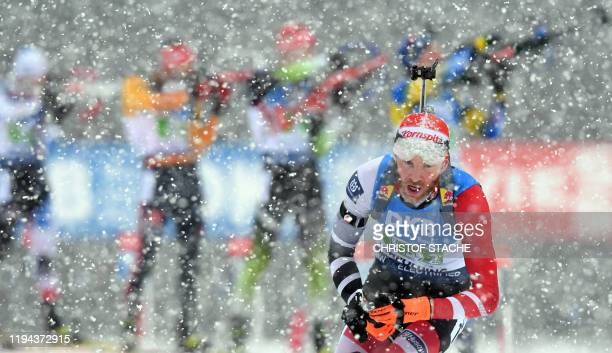 Austrian Simon Eder leaves the shooting range during the men's 4x75km relay event of the IBU Biathlon World Cup in Ruhpolding southern Germany on...