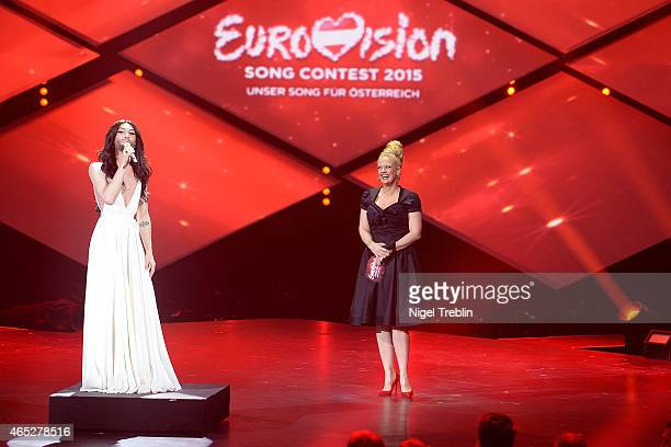Austrian singer and Eurovision Song Contest 2014 winner Conchita Wurst sings Happy Birthday for host Barbara Schoeneberger during the finals of the...