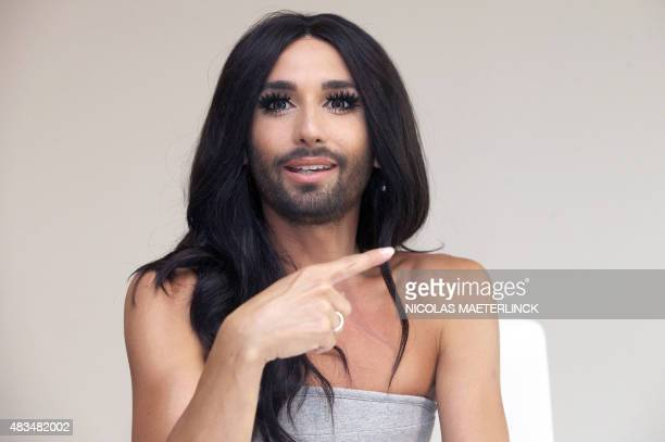 Austrian singer and former Eurovision winner Conchita Wurst gestures during a press conference in Antwerp on August 9 2015 after the Antwerp Pride...