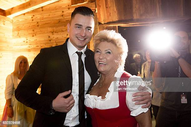Austrian singer Andreas Gabalier and Rosi pose for a picture at Rosi's Schnitzelparty on January 21 2017 in Kitzbuehel Austria