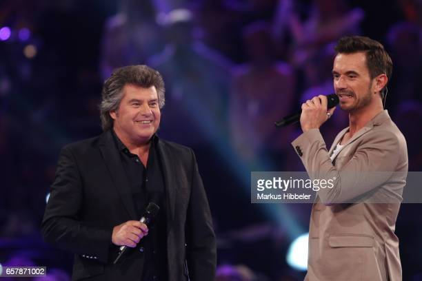 Austrian singer Andy Borg and Florian Silbereisen during the show 'Schlagercountdown Das grosse Premierenfest' at EWE Arena on March 25 2017 in...
