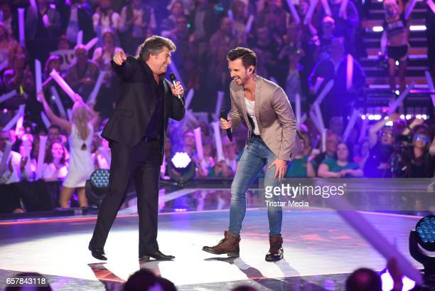 Austrian singer Andy Borg and german moderator Florian Silbereisen during the show 'Schlagercountdown Das grosse Premierenfest' at EWE Arena on March...