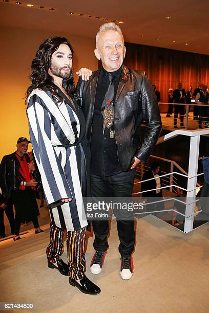 Austrian singer Conchita Wurst and fashion desigenr Jean Paul Gaultier arrive at the 23rd Opera Gala at Deutsche Oper Berlin on November 5 2016 in...