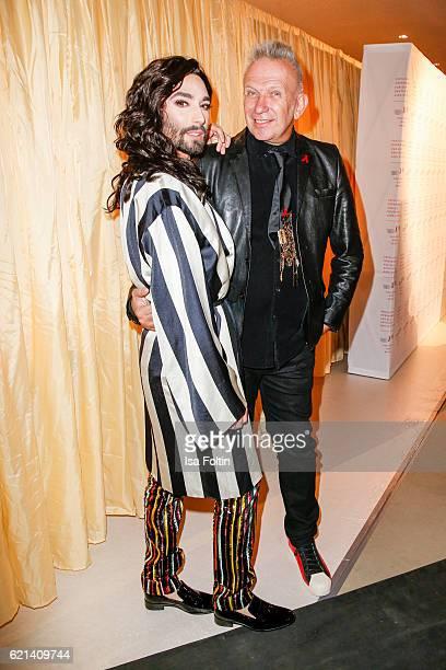 Austrian singer Conchita Wurst and fashion designer Jean Paul Gaultier arrive at the 23rd Opera Gala at Deutsche Oper Berlin on November 5 2016 in...