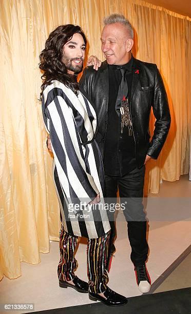 Austrian singer Conchita Wurst and french fashion designer Jean Paul Gaultier arrive at the 23rd Opera Gala at Deutsche Oper Berlin on November 5...