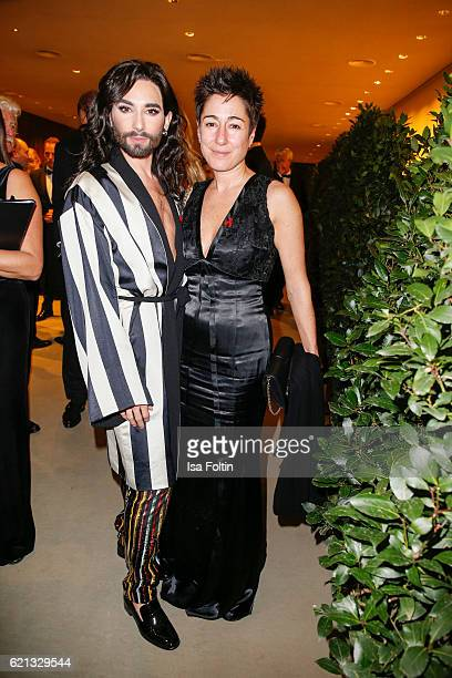 Austrian singer Conchita Wurst and german moderator Dunja Hayali attend the 23rd Opera Gala at Deutsche Oper Berlin on November 5 2016 in Berlin...