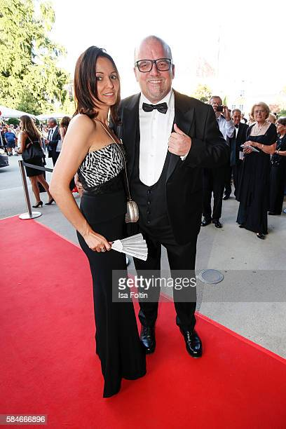 Austrian singer Gerhard Friedle alias DJ Oetzi and his wife Sonja Friedle attend the premiere of the opera 'Cosi Fan Tutte' on July 29 2016 in...