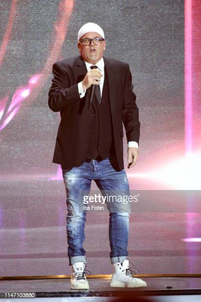 Austrian singer Gerry Friedle alias DJ Oetzi performs during the television show 'Willkommen bei Carmen Nebel' at Velodrom on May 4, 2019 in Berlin,...
