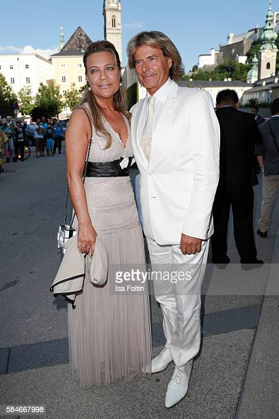 Austrian singer Hansi Hinterseer and his wife Ramona Hinterseer attend the premiere of the opera 'Cosi Fan Tutte' on July 29 2016 in Salzburg Austria
