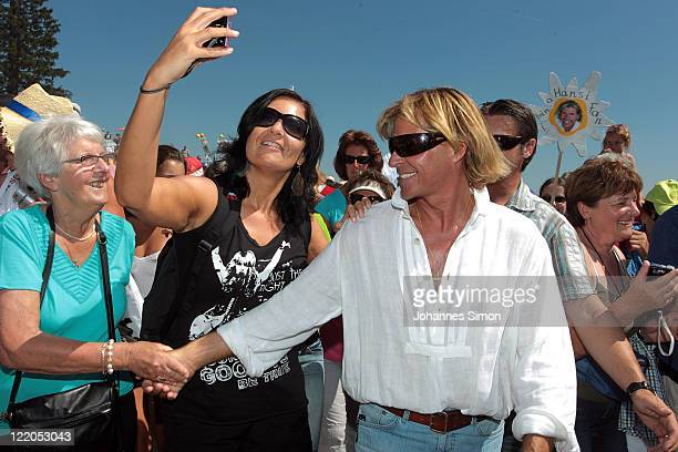 Austrian singer Hansi Hinterseer arrives for his annual fan hiking tour beginning at the peak of the Hahnenkamm mountain and ending at Fleckalm...