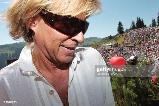Austrian singer Hansi Hinterseer arrives for his annual fan hiking tour beginning at the peak of the Hahnenkamm mountain on August 25, 2011 in...