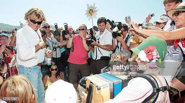 Austrian singer Hansi Hinterseer is welcomed by fans during his annual fan hiking tour beginning at the peak of the Hahnenkamm mountain on August 25,...
