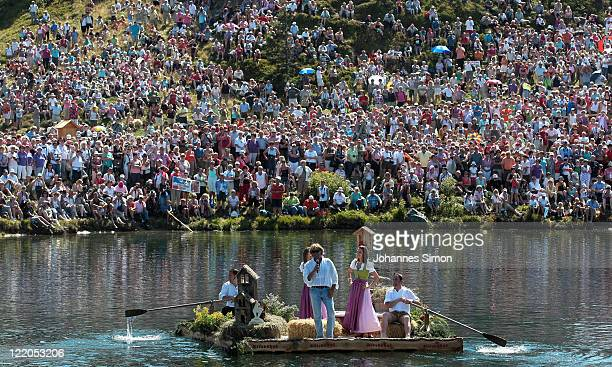Austrian singer Hansi Hinterseer performs during a boat trip as the grande finale of his annual fan hiking tour beginning at the peak of the...