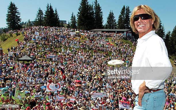 Austrian singer Hansi Hinterseer poses ahead his annual fan hiking tour beginning at the peak of the Hahnenkamm mountain on August 25, 2011 in...