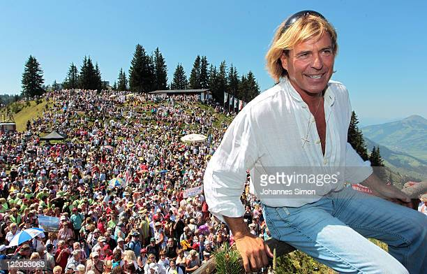 Austrian singer Hansi Hinterseer poses ahead of his annual fan hiking tour beginning at the peak of the Hahnenkamm mountain on August 25, 2011 in...